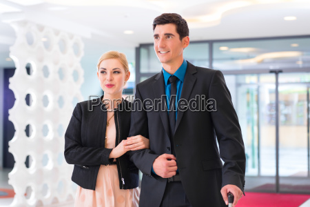 man and woman arriving at hotel