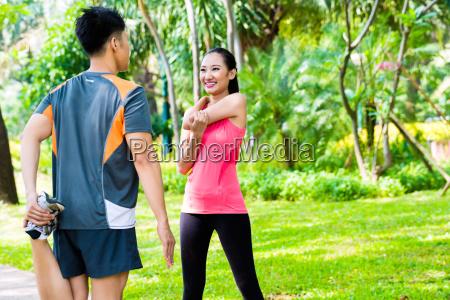 asian couple having outdoor fitness sport