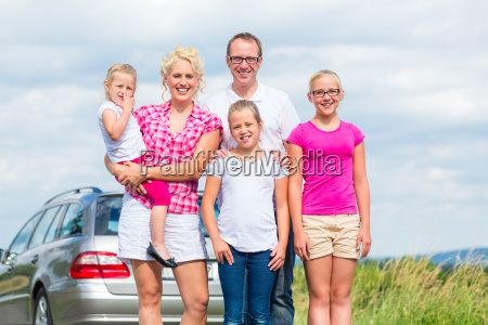 family standing together in front of