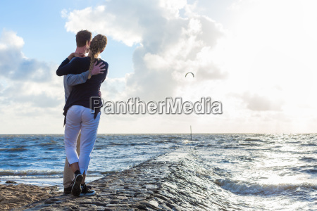couple in romantic sunset on ocean