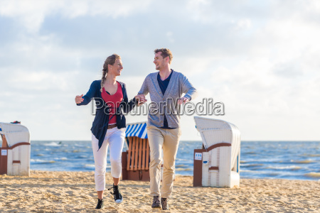 couple at romantic sunset on beach