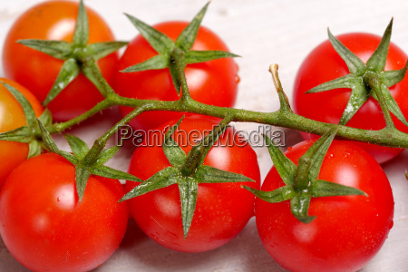 cherry tomatoes on a white wooden