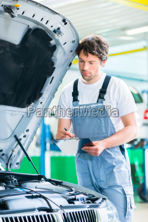 car mechanic working with tool in
