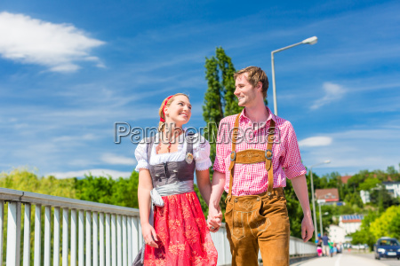 couple visiting bavarian fair having fun