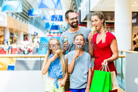 family eating ice cream in shopping