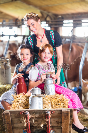 bavaria family driving pushcard in cow