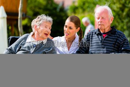old couple in garden of retirement