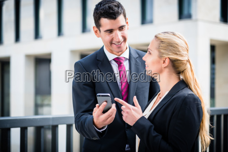 business man and woman working outdoors