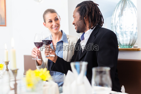 business people toasting on deal with