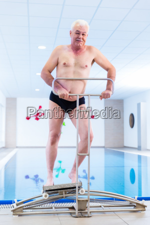 senior in water gymnastics therapy