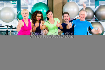men and women sitting on fitness