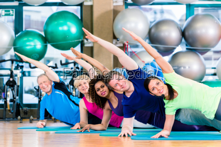 gymnastic group in gym exercising and