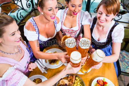 girls toasting with wheat beer in
