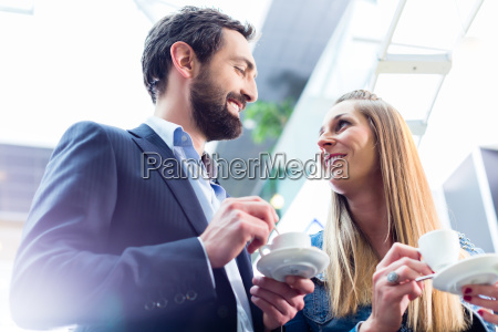 man flirting with woman while drinking