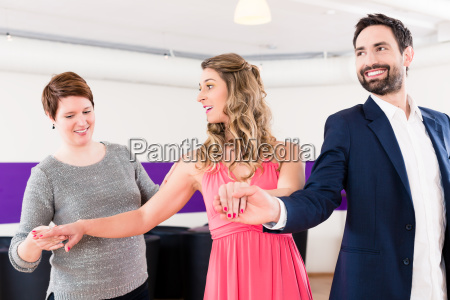 instructor in dance school with couple