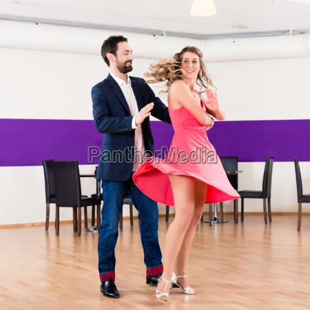 woman and man in dance school