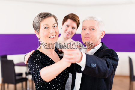 dance instructor with senior couple