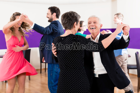 group of people dancing in dance