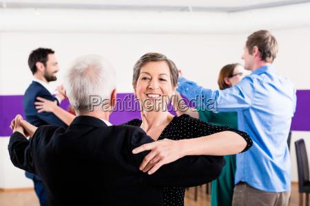 group of people dancing in dance