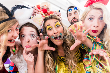 women and men celebrating at party