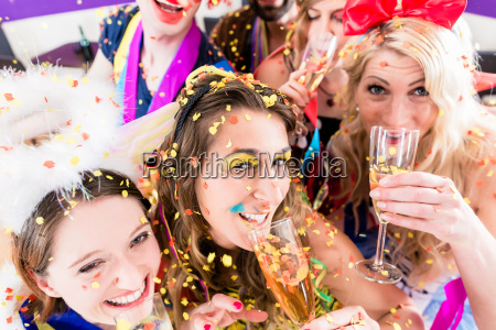 people on party drinking champagne
