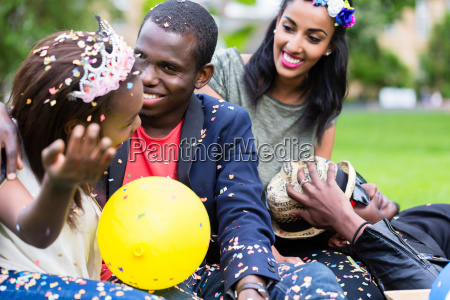 indian girl and african couple celebrating