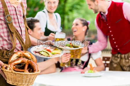 waiter serving food in bavarian beer