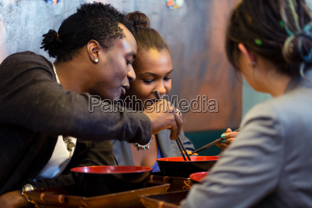 friends eating noodle soup in japanese