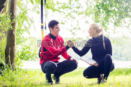 man and woman at fitness training
