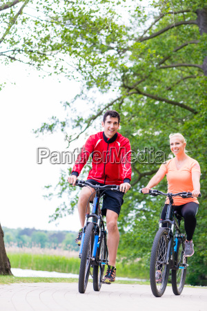 woman and man on mountain bike