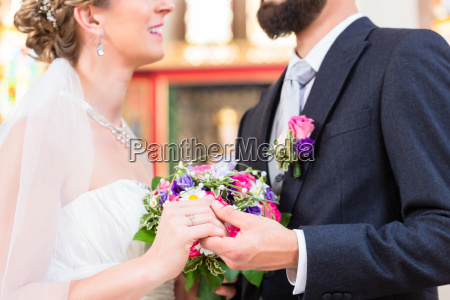 bridal couple in church having wedding