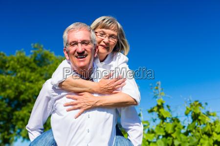 senior woman hugging her man from