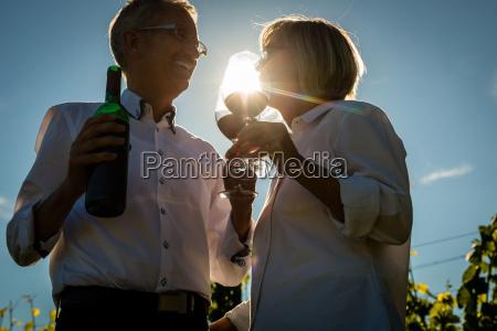 senior woman and man drinking wine