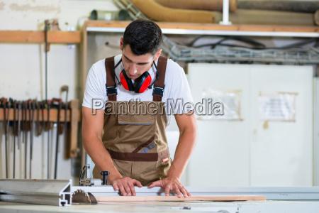 carpenter or cabinet maker in his