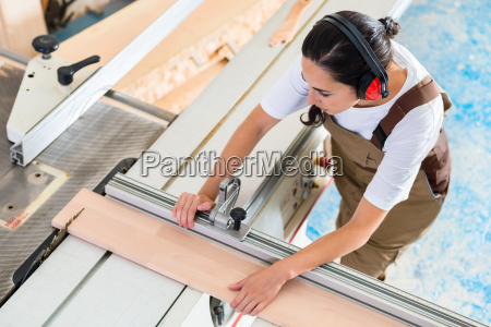 carpenter woman working in her workshop