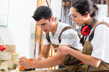 carpenter team of woman and man