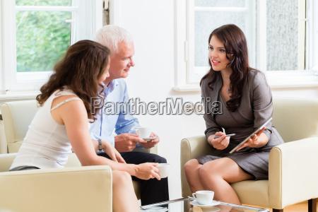 advisor giving investment advice to senior