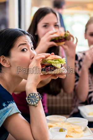 portrait of three young women eating
