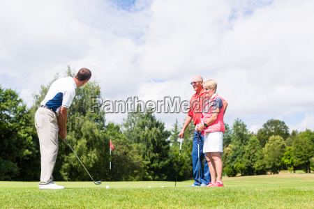 golf pro practicing the sport with