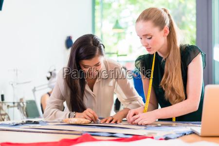 fashion designer or tailors sketching pattern