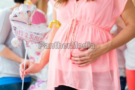 pregnant girl celebrating baby shower party
