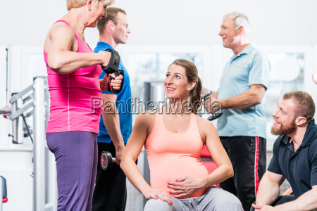 pregnant woman with senior people working