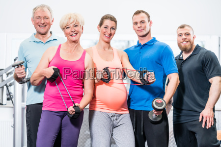 group of people in gym with