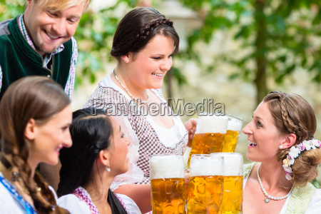 waitress serving beer in beer garden