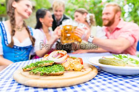 friends in beer garden with drink