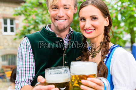 couple wearing tracht posing with glasses