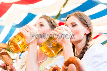 friends in bavarian beer tent drinking