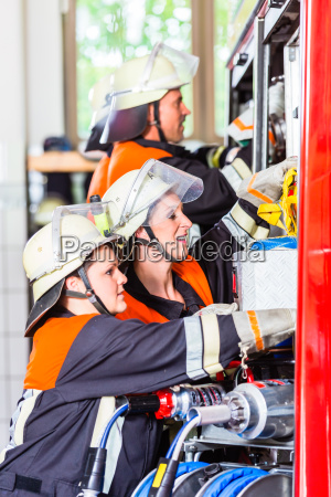 fire fighters attaching hose at hose
