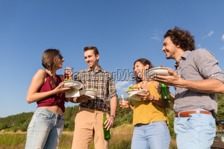 friends at bbq party in nature