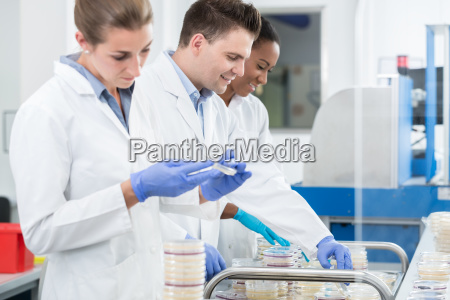 group of researchers using scientific technology